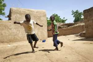 Two displaced children play in Mali, which has been wracked by an Islamist insurgency that has taken a brutal toll on the youth in the Sahel.  By MICHELE CATTANI (AFP/File)