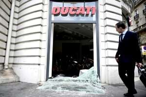 Two stores near the Champs-Elysees in Paris were looted, including a motorcycle shop where people took helmets, gloves and even bikes.  By Philippe LOPEZ (AFP)