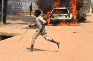 Two people were killed in Kofa, northern Nigeria, in election-related clashes on Thursday -- deaths from political violence have been running at an average of two per day since October. By PIUS UTOMI EKPEI (AFP)