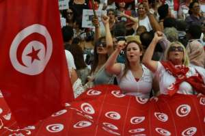 Tunisian women demonstrate in Tunis on August 13, 2018, to mark Tunisia's Women's Day and to demand equal inheritance rights between men and women.  By FETHI BELAID (AFP)