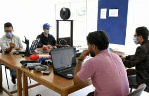 Tunisian engineers test a prototype of an artificial hand, which they hope will be produced at a lower price than existing prostheses.  By Bechir TAIEB (AFP)