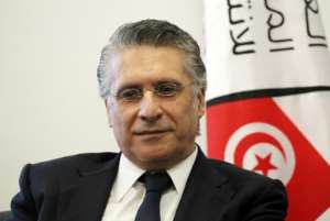 Tunisian media magnate and presidential candidate Nabil Karoui, pictured in early August, before he was detained in a money laundering probe.  By Hasna (AFP/File)