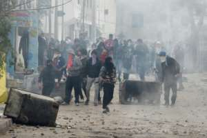 Tunisian protesters clash with security forces in the town of Tebourba on January 9, 2018, following the funeral of a man who died the previous day in unrest