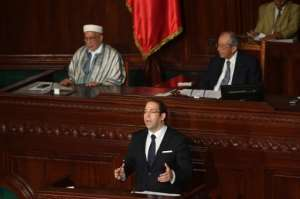 Tunisian Prime Minister Youssef Chahed addresses parliament in Tunis ahead of a vote of confidence in his reshuffled government on September 11, 2017