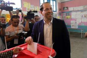 Tunisian Prime Minister Youssef Chahed and presidential hopeful casts his ballot in the elections, but he could emerge as the biggest loser of the polls with early returns putting him in fifth place.  By Fethi Belaid (AFP)