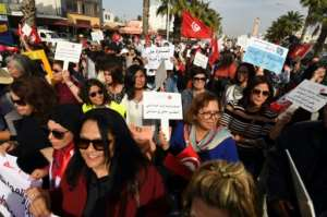 Tunisians protest in March 2018 in support of equal inheritance rights for women, one of several reforms currently opposed by conservative Muslim groups across the country.  By FETHI BELAID (AFP/File)