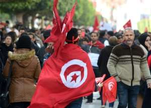 Tunisians rally in  Tunis to mark the eighth anniversary of the 2011 revolution that toppled their longtime dictator on January 14, 2019.  By Fethi Belaid (AFP)