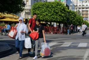 Tunisians were back on the streets of the capital a day after twin suicide bombings claimed by the Islamic State group.  By FETHI BELAID (AFP)