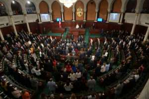 Tunisia's new President Kais Saied received a rousing round of applause from a packed parliament when he vowed to uphold women's right.  By FETHI BELAID (AFP)