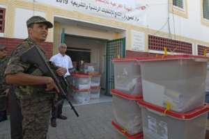 Tunisia's parliamentary election comes just before an October 13 two-way run-off in a presidential contest pitting a jailed business tycoon against a law professor.  By FETHI BELAID (AFP)