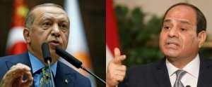 Turkish President Recep Tayyip Erdogan (L) and Egyptian President Abdel Fattah al-Sisi back oppositing sides in Libya's civil war.  By KAYHAN OZER, Ludovic MARIN (AFP/File)