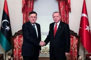 Turkish President Recep Tayyip Erdogan met Fayez al-Sarraj, the head of the Tripoli-based Government of National Accord, in November.  By Mustafa Kamaci (TURKISH PRESIDENTIAL PRESS SERVICE/AFP/File)