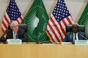 Turn the page: US Secretary of State Rex Tillerson, at a press conference with the African Union's Moussa Faki.  By SIMON MAINA (AFP)