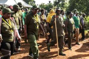 Ugandan President Yoweri Museveni and veterans and Members of Parliament, ready to march through the jungle as he retraces the route which his rebel forces took 35 years ago.  By Hajarah Nalwadda (AFP)