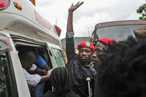 Ugandan singer-turned-politician Robert Kyagulanyi (C), better known as Bobi Wine, has finally left Kampala for medical treatment in the United States following allegations of torture.  By Stringer (AFP/File)