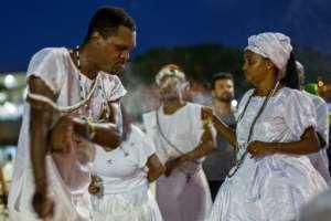 Umbanda faithfuls pray and dance to Iemanja, the goddess of the sea from the ancient Yoruba mythology and one of the most popular deities of the Afro-Brazilian culture, at Copacabana Beach in Rio de Janeiro.  By Daniel RAMALHO (AFP)