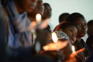 Rwandan women hold candles during a night vigil and prayer in Kigali on April 7, 2014, for the 20th anniversary of Rwanda's genocide.  By Simon Maina (AFP/File)