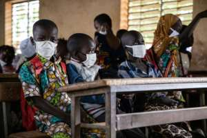 Unlike these pupils in Ouagadougou, displaced children are lucky to have basic materials and some have lessons under the trees.  By OLYMPIA DE MAISMONT (AFP/File)