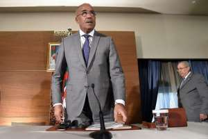 Unpopular prime minister Ahmed Ouyahia was replaced by former interior minister Noureddine Bedoui (C) - a move that has failed to convince many protesters. By RYAD KRAMDI (AFP)