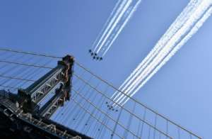US military planes fly over New York in a salute to health care workers. By Angela Weiss (AFP)