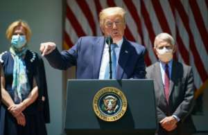 US President Donald Trump, flanked by senior health officials, launches the 'Operation Warp Speed' initiative which he says could deliver a vaccine by the end of the year.  By MANDEL NGAN (AFP)