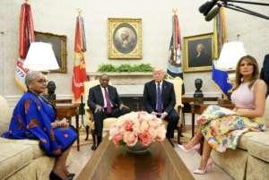 US President Donald Trump, right, Kenya's President Uhuru Kenyatta and their wives Melania Trump and Margaret Kenyatta meet in the White House Oval Office.  By MANDEL NGAN (AFP)