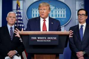 US President Donald Trump said he would have a recommendation 'before Easter' on whether parts of the US can reopen.  By MANDEL NGAN (AFP)