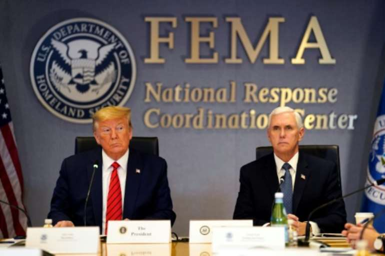 US President Donald Trump, seen here with Vice President Mike Pence, lashed out at China for not informing the world sooner about the coronavirus outbreak. By Evan Vucci (POOL/AFP)