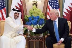 US President Donald Trump shakes hands with Qatar's Emir Sheikh Tamim Bin Hamad Al-Thani, in the Saudi capital Riyadh on May 21, 2017