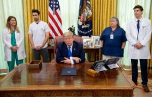 US President Donald Trump speaks about COVID-19 in the Oval Office of the White House.  By SAUL LOEB (AFP)