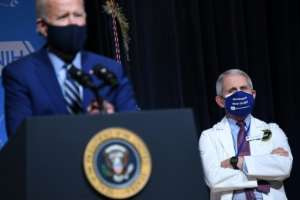 US President Joe Biden (L) appears alongside his top virus expert Anthony Fauci, who says a sense of normalcy may only return by the end of 2021.  By SAUL LOEB (AFP/File)