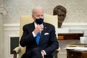 US President Joe Biden wants Americans to keep wearing masks as much as possible.  By Brendan Smialowski (AFP)