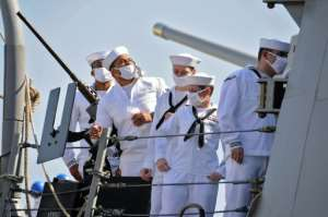US sailors stand aboard the USS Winston S. Churchill while it anchors in Port Sudan.  By - (AFP)