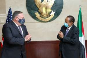 US Secretary of State Mike Pompeo, on a rare visit to Sudan in August 2020, greets Sudanese Prime Minister Abdalla Hamdok amid talks on removing Khartoum as a state sponsor of terrorism. By Handout (Office of Sudan's Prime Minister/AFP/File)