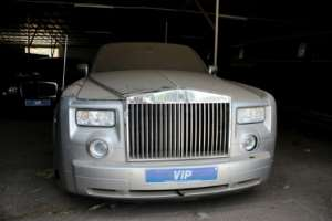 Up for grabs: One of former president Jammeh's Rolls-Royces. His fleet of luxury cars and presidential jets is being sold to raise money for health and education.  By CLAIRE BARGELES (AFP)