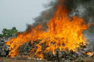Up in smoke: Fake drugs are destroyed in Ogun State, southwest Nigeria after being seized by watchdogs.  By PIUS UTOMI EKPEI (AFP)
