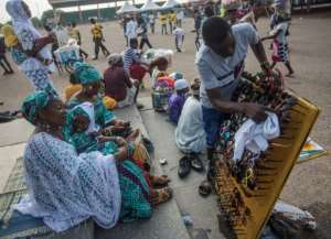 Vendors sell merchandise in Independence Square in Accra.  By CRISTINA ALDEHUELA (AFP/File)