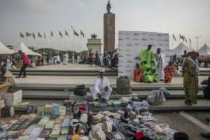 Vendors selling merchandise in Accra's Independence Square, part of the waterfront area earmarked for development.  By CRISTINA ALDEHUELA (AFP)