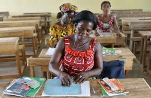 Village women are also attending classes, with the emphasis on literacy.  By ISSOUF SANOGO (AFP/File)
