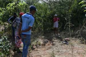 Villagers look on where an elephant trampled a man to death on his way to work in April -- the Botswanan cabinet this week noted