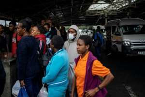 Virus worry: Some passengers at Johannesburg taxi ranks have started to don masks.  By Michele Spatari (AFP)