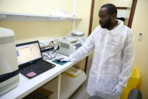 Viral sleuth: doctor Illich Mombo analyses the results of an Ebola test at the Franceville International Centre for Medical Research.  By STEVE JORDAN (AFP)