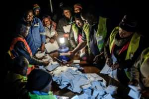Vote counting goes into the night in the suburb of Mbare in Zimbabwe's capital Harare.  By Luis TATO (AFP)