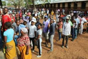 Voters lined up in long queues outside ballot stations from early Wednesday morning, with results due on Thursday.  By Roberto MATCHISSA (AFP)