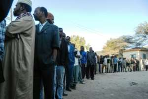 Voters wait in a line to cast their ballots in Somaliland's presidential election with biometric eye scanners used to identify them before voting.