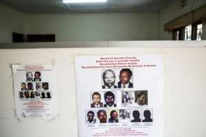 Wanted: A poster showing suspects at the headquarters of the Genocide Fugitives Tracking Unit, which 25 years later is still hunting perpetrators of the slaughter. By Jacques NKINZINGABO (AFP)