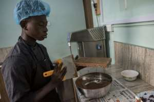 Waste not: Scraping excess chocolate from a mold.  By CRISTINA ALDEHUELA (AFP/File)