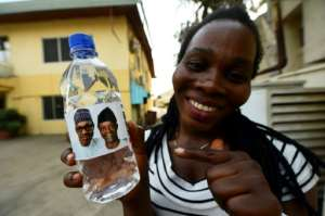Water works? Bottled water bearing the image of Nigeria's President Mohammadu Buhari and his vice president ahead of Saturday's rescheduled elections.  By Pius Utomi EKPEI (AFP/File)