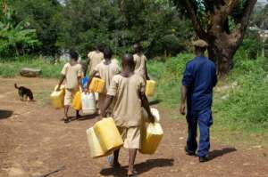 Water is so scarce at Bo prison that inmates are sent out under escort to fill jerricans from streams or wells -- the trek can be several kilometres.  By Saidu BAH (AFP)