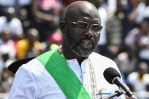 Weah's inauguration in January 2018 marked Liberia's first transition between democratically-elected leaders since 1944.  By ISSOUF SANOGO (AFP)